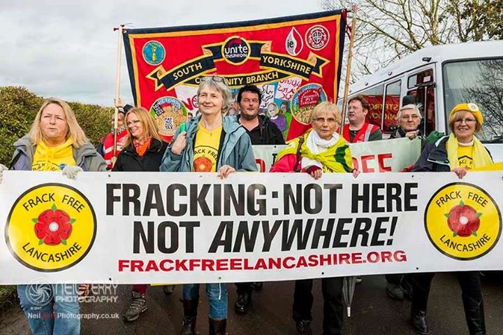 Frack Free Lancashire protesters marching in Kirby Misperton, holding a banner
